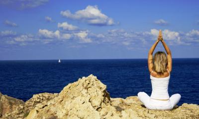 Yoga retreat - exercise on the rocks